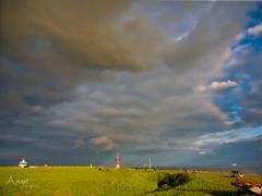 Clouds above the Westerschelde (Wilma van Oorschot) Tags: wilmavanoorschot angelphotography olympusem5 olympusomde5 olympus mzuikodigitaled1250mm13563 westerschelde hansweert zeeland outdoor nature clouds river