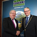 Outgoing President Joe Dolan congratulates incoming President, Michael Lennon