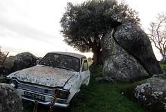 culture clash (lualba) Tags: megalithsite megalithanlage schrottauto auto car demolishedcar alentejo portugal