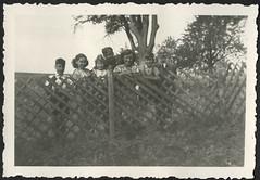 AlbumC144 Familienfoto am Holzzaun, 1930-1950er (Hans-Michael Tappen) Tags: archivhansmichaeltappen albumc 19301950er familie familienfoto bart opa holzzaun kleidung uniform wehrmacht drittesreich thirdreich nazigermany fotorahmen outdoor landschaft