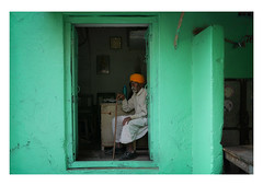 contemplation (handheld-films) Tags: india man portrait doorway home house green elderly old aged sitting seated rural rajasthan indian travel individual people subcontinent