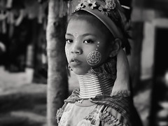 Karen Long Neck Tribe (Carl's Captures) Tags: karenlongnecktribe baantongluangvillage maerimdistrict chiangmaithailand kayanpeople portrait brassneckcoils tradition culture tribespeople fromburma frommyanmar fledtothailand padaung history northernthailand southeastasia asian ethnicity hilltribe tourism girl child youth monochrome traditionaldress tribal nikond7500 sigma18300 photoshopbyfehlfarben thanksbinexo