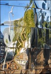 Big city monster (Logris) Tags: reflection spiegelung reflections spiegelungen fassade facade aluminium chrom chrome fantasie fantasy abstract abstrakt