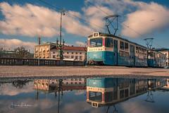 Gothenburg - A new Day (Fredrik Lindedal) Tags: tram train reflection reflections bridge clouds gothenburg göteborg sky skyline city cityscape cityview lindedal