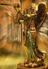 Angel Sounding The Trumpet (Anthony Mark Images) Tags: soundingthetrumpet angel goldangel thealarm soundingthealarm goldentrumpet sculpture bronners frankenmuth michigan usa art gold windowdisplay biblical christmasstore nikon d850 brass brassstatue