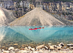 Canoes on Moraine Lake (bhotchkies) Tags: canada lake morainelake alberta canoes reflections nationalpark banffnationalpark