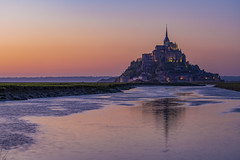 Mont Saint Michel at Sunset (Alexander JE Bradley) Tags: magical 70200mmf28 afsvrzoomnikkor70200mmf28gifed nikon70200mmf28fl d500 nikon nikkor europe france normandy lowernormandy bassenormandie manche montsaintmichel fortifications island monumenthistorique mtsaintmichel saintmichaelsmount environment architecture frenchgothic bastions buildings building religious church monastery abbey monasticfraternitiesofjerusalem residential spire citywalls fortificationtowers history landscape hinterland lookout viewpoint scenic seascape nature noperson hill grass twilight alexanderjebradley photograph photography travel tourism travelphotography wwwalexanderjebradleycom wwwaperturetourscom aperturetours normandyloirevalleyworkshop unesco worldheritage heritage montsaintmichelanditsbay dreamlike dreamy barragedumontsaintmichel monument town water tide hightide canal fr
