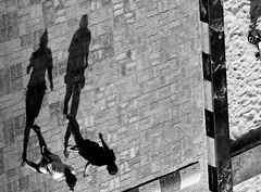 The Jogging Shadows (Sriini) Tags: people monochrome black white blackandwhite jogging shadows artistic street girls cobble stones pavement nikon d3300 nikkor sundaylights