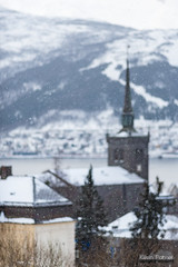 Snowy Steeple (kevin-palmer) Tags: narvik norway arctic march winter snow snowy cold morning cloudy overcast scandinavianmountains nikond750 nikon180mmf28 telephoto church steeple sea arcticocean ofotfjord