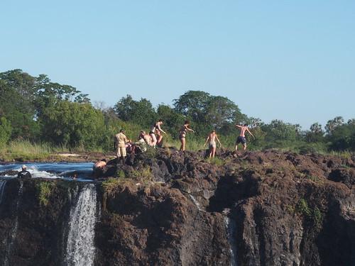 Tourist bathing on Zambia side of Falls