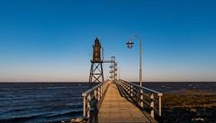 Leuchtturm Obereversand (130 Jahre alt) an der Nordsee (gabrieleskwar) Tags: outdoor himmel meer wasser nordsee brücke steg laternen holz geländer wellen treppen leuchtturm sonne farbe formen