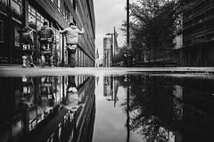Ole Ole (Zesk MF) Tags: bw black white puddle reflection fans people candid street rain zesk cologne x100f fuji dom pfütze