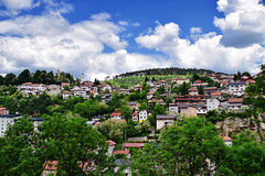 View of Sarajevo (Jocelyn777) Tags: landscapes mountains clouds sky view vista buildings architecture cityviews trees foliage sarajevo bosniaandherzegovina balkans travel