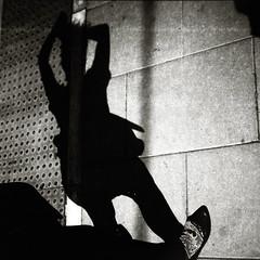 Ghosts walking at midday (O9k) Tags: diana lomography toycamera plasticcamera analog analogue selfdeveloped lomo mediumformat 6x6 blackandwhite bw homedeveloping streetphotography shadow lofi plasticlens film ilforddelta400