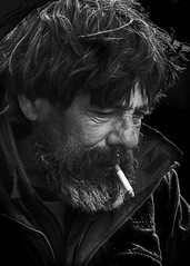 Portrait (D80_529544) (Itzick (away until 1st. April)) Tags: denmark candid copenhagen bw blackbackground bwportrait beard cigarette streetphotography smoking man face facialexpression portrait d800 itzick