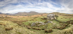 Llwyn y Bettws (Ffotograffiaeth Dylan Arnold Photography) Tags: house abandoned derelict ruin remote desolate rustic bucolic countryside wales cymru panorama panoramic outdoors outside farmhouse farming agriculture hardlife rural green spring sheep landscape nantlleridge moelhebog moelyrogof moellefn mountains cwmpennant beautiful peaceful quiet bleak stones reeds clouds sky still pastures hills trees hawthorn lonetree barn wall drystonewall stone blue russet wide copyspace welsh landscapephotographer landscapephotography hiddenwales cymrucudd snowdonia eryri