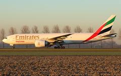 Emirates SkyCargo Boeing 777-F1H A6-EFI / AMS (RuWe71) Tags: emiratesairline ekuae emirates emiratesskycargo unitedarabemirates dubai boeing boeing777 boeing777f b777 b777f b772 b777200 b777200f b777f1h boeing777200 boeing777200f boeing777f1h a6efi cn356091060 amsterdamairport amsterdamschiphol amsterdamschipholairport schiphol schipholamsterdam schipholairport ams eham widebody twinjet freighter taxiing cargo cargoaircraft goldenhour sunsrise dawn