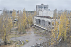 Pripyat Rooftop (Jonnie Lynn Lace) Tags: abandoned ukraine chernobyl pripyat при́пять чорнобиль light day classic history time nuclear disaster green white yellow ruins ruinas nikkor nikon d750 50mm digital flickr travel trip europe european exploration explore urbex texture textures derelict decay detail leaves fall autumn automne rooftop city view aerial architecture art building buildings old historic tree landscape road cityscape jonnielace palace culture historical