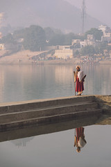 0896 Morning Stroll (Hrvoje Simich - gaZZda) Tags: outdoors buildings water lake people man wiseman red stroll morning walk pushkar india asia travel nikon nikond750 sigma150500563 hrvojesimich gazzda
