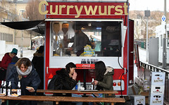 Currywurst (Anthony Mark Images) Tags: currywurst chipwagon berlinderkindlbeer beer picnictables frenchfries cocacola fastfood people portrait streetphotography candid ladies berlin germany deutschland eating outside museumdistrict nikon d850