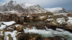 Cold flow... (Lee Harris Photography) Tags: landscape river flowing longexposure rugged wales snowdonia snow rocks mountains mountain mirrorless light water bridge llynidwal outdoor contrast lumixg9 sky cloud mood