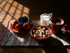 Breakfast [FlickrFriday] [Still Life] (trustypics) Tags: breakfast stilllife blueberries coffee milk oats oranges shadow sun table