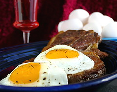 The Breakfast of Champions (Eat With Your Eyez) Tags: sunnysideupeggs fried eggs yellow yolks whites pork steak should roast browned tender meat cranberry juice drink glass natural light bokeh panasonic fz1000 breakfast of champions meal food foodphotography foodstyling foodporn homechef chef