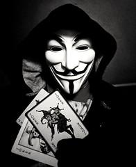 Pick a card (1 of 4) (PhotoJester40) Tags: indoors inside blackwhite bw blkwhite me memyselfandi masked posing guyfoxmask amdphotographer noirblanc blackandwhite jokercards goth gothic mysterious 1of4 male