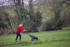 DSC_5067 Scawby North Lincolnshire Lady in Red Sweater Cutting the Grass on the Public Right of Way used by Dog Walkers (photographer695) Tags: scawby north lincolnshire lady red sweater cutting grass public right way used by dog walkers