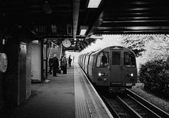 on our way out, burnt oak underground station. using a Konica Hexar RF - Voigtlander nokton 40mm 1.4 - Ilford FP4 plus. Developed in ilfosol 3 (cjthorose) Tags: filmphotography 35mm ilford ilfosol3 fp4plus londonunderground tube blackandwhite