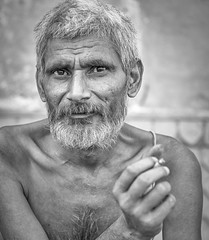 poised for insight (andy_8357) Tags: man sanyasi varanasi engaged brahmin outdoors uttar pradesh blackandwhite bw blanco y negro black white monochrome detail sigma 60mm f28 dn art prime sony a6000 alpha ilce6000 ilcenex portraiture street natural light ganges gra salt pepper gray hair keen eyes intelligent philosophical beard mostache smoking cigarette lively lens stimulating conversationalist gentleman gentle kind people person