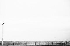Knott End-on-Sea, minimalism. (Bearded Shooter) Tags: street streetphotography minimalism knottend knott end sea bench light railings landscape seascape blackwhite bw waves cafe lancashire ride motorcycles yamaha fujifilm xe1