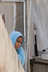 Blue hood, Irbid, Jordan (mistermacrophotos) Tags: frown quiet portrait people jordan mk4 5d canin east middle lens long candid child wall curious hoodie blue alkarmel