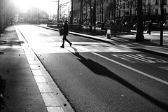 At the end of his shade (pascalcolin1) Tags: paris13 homme man ombre shade soleil sun passagepiéton crosswalk lines lignes route road photoderue streetview urbanarte noiretblanc blackandwhite photopascalcolin 50mm canon50mm canon