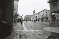 Piazza Tre Martiri (goodfella2459) Tags: nikonf4 afnikkor24mmf28dlens fujifilmneopanacros100 35mm blackandwhite film analog rimini italy buildings streets bwfp manilovefilm piazzatremartiri federicofellini amarcord