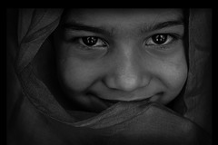 Keep Smiling (geeta_maurya) Tags: bw blackandwhite chandapark keepsmile smiling curtain innocence expressions bigeyes portrait naturallight texture places morningshot dramatic human monochrome people fineart fineartphotography art artistic travel incredibleindia beauty geetamaurya delhi india