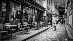 Le Procope, Paris (2D110) Tags: restaurant bw homme street 35mm leicamp240 paris leprocope