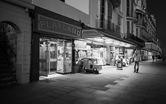 Playland (Mandy Willard) Tags: hastings amusement arcade street pavement light night mono