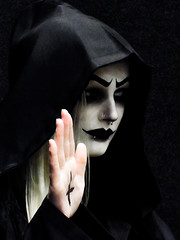 Peace Lives in the Darkness (Steve Taylor (Photography)) Tags: hand cross hood eyebrows nosering stud black contrast grey pink lady woman newzealand nz southisland canterbury christchurch shadow addington armageddonexpo armaggedon costume makeup starwars