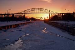 sunset (twurdemann) Tags: 06ndsoftgrad fujixt1 ice internationalbridge leeseven5 ontario parkscanada reflection saultcanal saultstemarie snow spring stmarysisland sunset viveza xf1855mm
