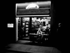 Via del Corso (Pierrot le chat) Tags: florence italy firenze italia streetphotography night blackandwhite noiretblanc restaurant scènederue