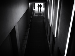 the passage (Sandy...J) Tags: atmosphere monochrom mono mood silhouette photography people passage street streetphotography sw schwarzweis strasenfotografie stadt shadow light darkness city germany deutschland blackwhite bw black white backlight urban noir olympus fotografie lines