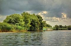 Romania (denismartin) Tags: delta river romania danube donau danubedelta worldheritagesite unescoworldheritagesite tulcea дельтадунаю tulceacounty riverdelta nature riverbank leveeecosystems leteaforest letea boat cloud sky