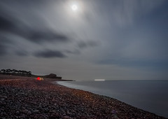 Moonlight fishing (Vigor11) Tags: budleighsalterton sea ocean mackerel fishing beach stones boat lighttrails trees cliff cloudy clouds sky night dark horizon distance tent people moon moonlit silhouette englishchannel uk devon longexposure light fisherman man red yellow grey silvery silver speeding motion brown greenshadows landscape water rock seaside