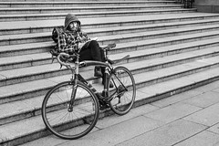 Reader (johnjackson808) Tags: stairs vancouver bicycle steps monochrome reading people fujifilmxt3 streetphotography man book blackandwhite bw downtown