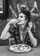 When your friends make you taste the real pizza for the first time (De Mi Ser) Tags: candid street girl beauty city urban pizza monochrome blackandwhite smile