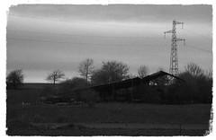 (Jean-Luc Léopoldi) Tags: bw noiretblanc sablé campagne pylône grange barn gloomy lugubre cielgris désert