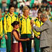 Members of the hockeyroos receive their gold medals from Commonwealth Secretary General Kamalesh Sharma at the 2010 Commonwealth Games