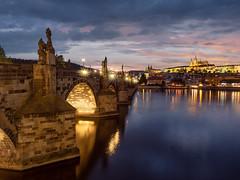 Other side, other sight (v-_-v) Tags: prague karlsbrücke charles bridge castle river sunset water clouds karluv most moldau czech republic blue hour europe cityscape travel