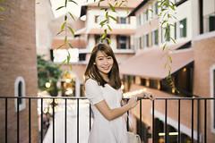 Lily II (KamrenB Photography) Tags: kamgtr kamrenb portrait portraiture white dress leaves girl smile asia thailand asian chiang mai chiangmai smiling bokeh canon 6d evening